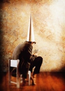 Dunce Holding Paper Money ca. 2001