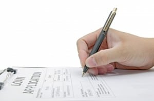 Person Siging On Loan Application