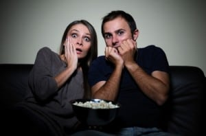Young Couple Watching Scary Movie